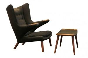 a 1950's model AP19 'Papa Bear' armchair and footstool