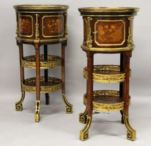 A pair of tulipwood, marquetry inlaid and ormolu guéridons