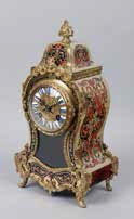 A fine quality French boulle and red tortoiseshell mantel clock