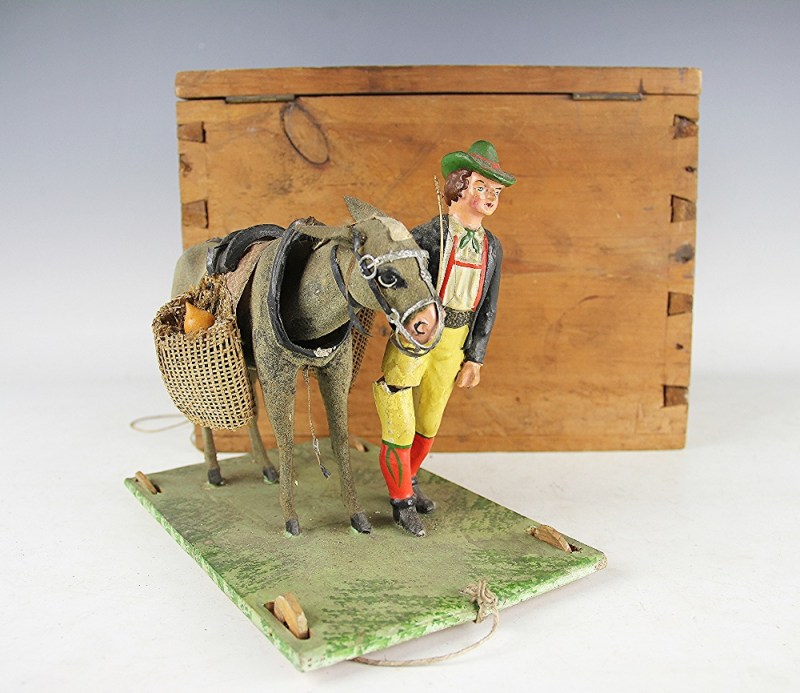 A 19th century folk art model of a man and his donkey sold for £4,100