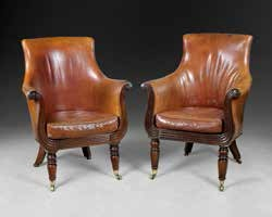 A pair of mahogany and upholstered leather armchairs by Gillows