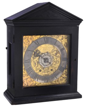 An important early ebony spring pendulum timepiece with alarm, Edward East, London, circa 1660