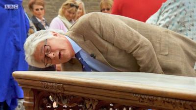 Christopher Payne inspects the 20000 table on Antiques Roadshow