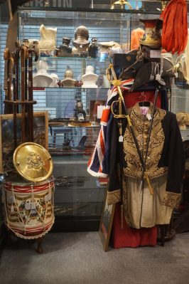 Collecting military antiques can include uniforms and weapons like these in Leon's shop
