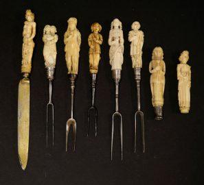 Carved handles on antique knives