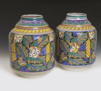 Poole Pottery vases decorated in the 'Holly' pattern