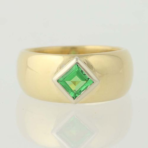 Contemporary 18 Karat Gold And Bezel Set Merelani Mint