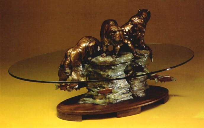 a glass top coffee table with bronze sculpture base by daniel parker i image courtesy of coeur d alene art auction i