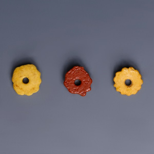 Egyptian Faience Red and Yellow Daisy Amulets