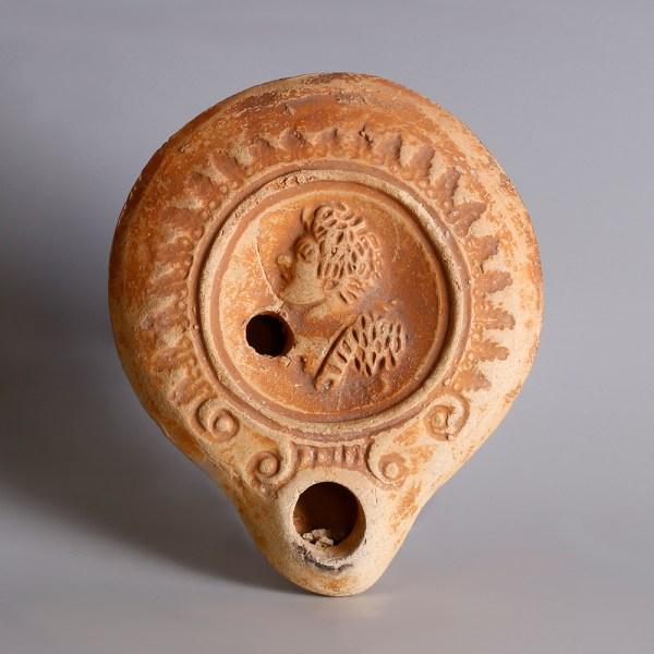 Roman Oil Lamp with Male Figure