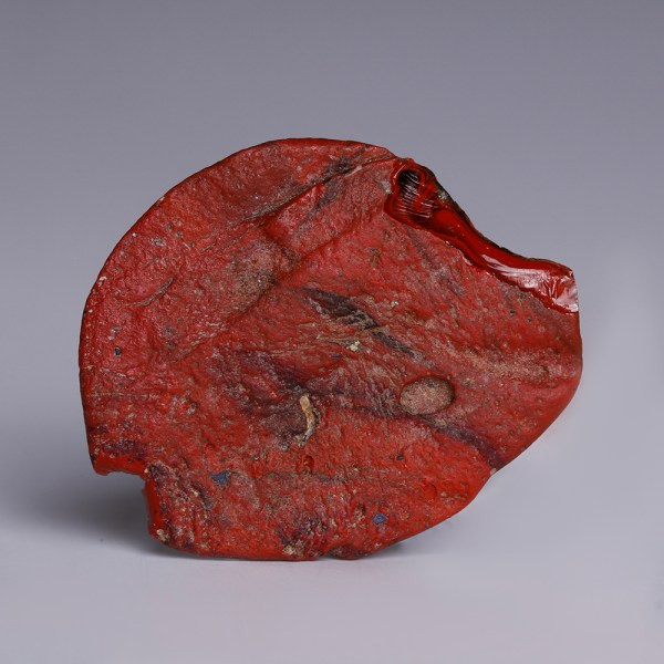 An Egyptian Red Faience Plaque of a Fish