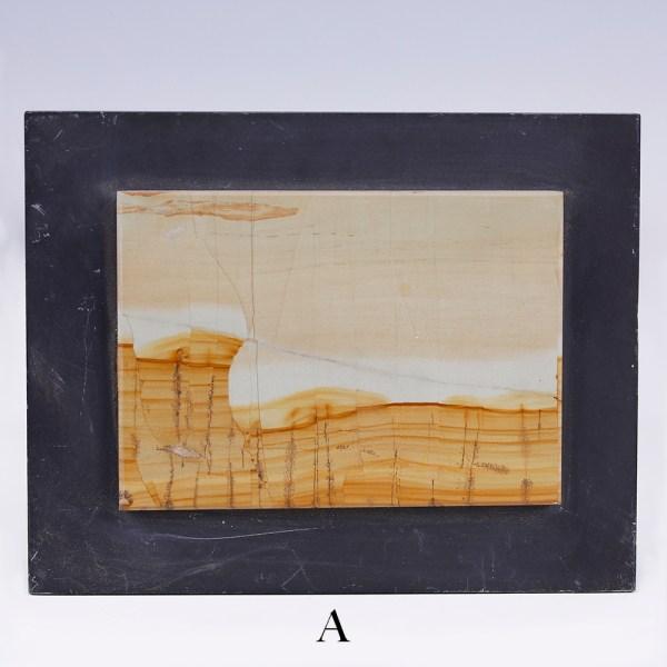 selectionof small landscape stone slabs on slate a