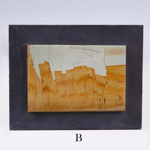 selectionof small landscape stone slabs on slate b