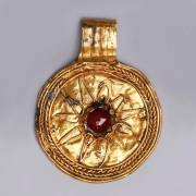 Hellenistic Gold Medallion Pendant with Sun Star