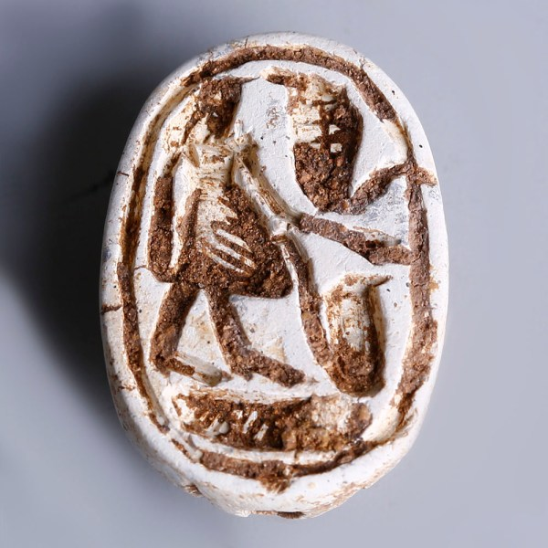 Large Egyptian Steatite Scarab with a Falcon-headed God and a Uraeus