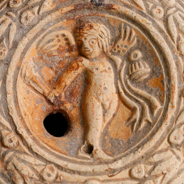 Ancient Roman Terracotta Oil Lamp with Cupid