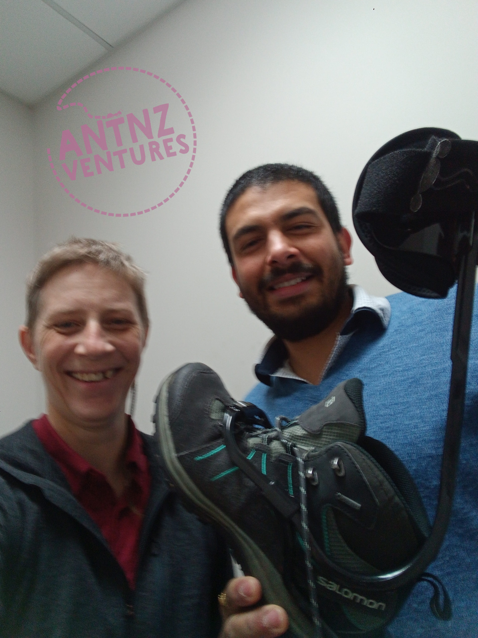 A selfie of Antnz and Arjun from Central Orthotics. Arjun is holding a hiking boot with the TurboMed Extern fitted to it.