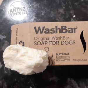 "Picture Description: A picture of a brown recycled cardboard box with a chewed piece of soap about 1/3 of the box size. The cardboard box reads in bold at the top left ""WashBar"". Then below and smaller font ""Original WashBar"". Then below smaller bold font in Caps ""SOAP FOR DOGS"". The chewed soap takes up the final 1/3 of the lower box. Next to the soap the box reads ""Natural Ingredients, No Nasties""."