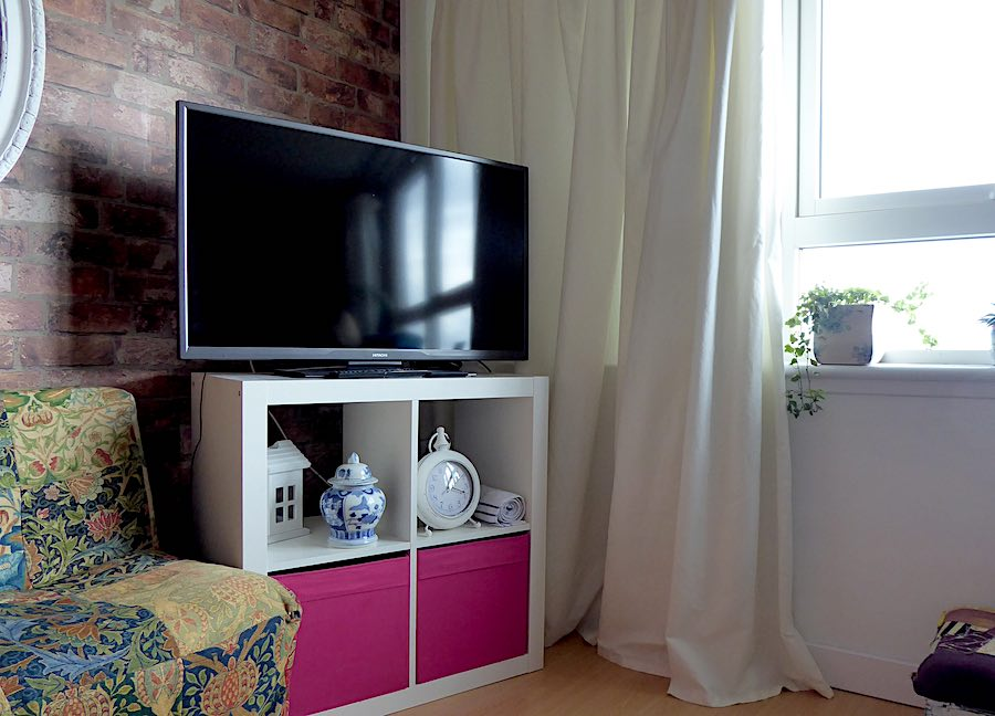 TV and curtain in high-rise