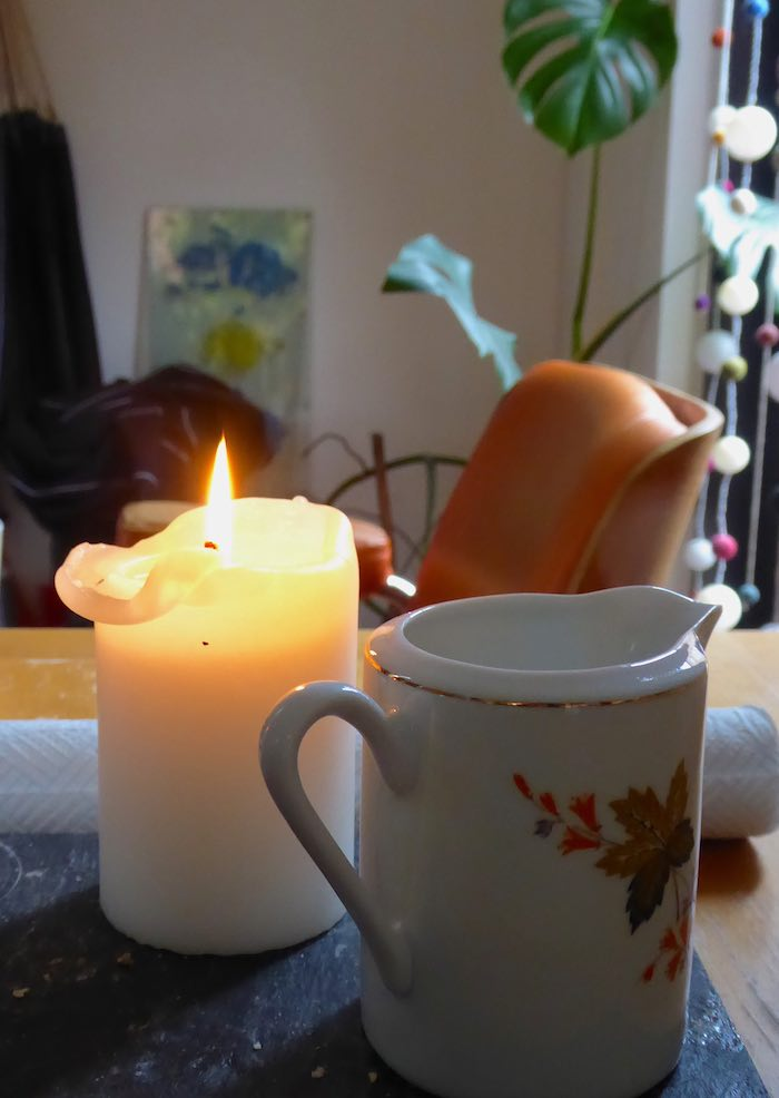 candle, jug and calm lives
