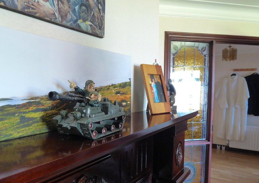 toy tank, fireplace, picture and doorway