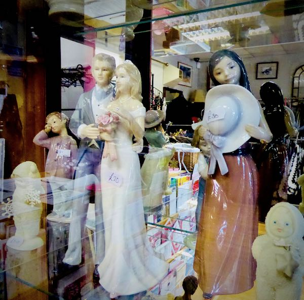 charity shop display of figurines