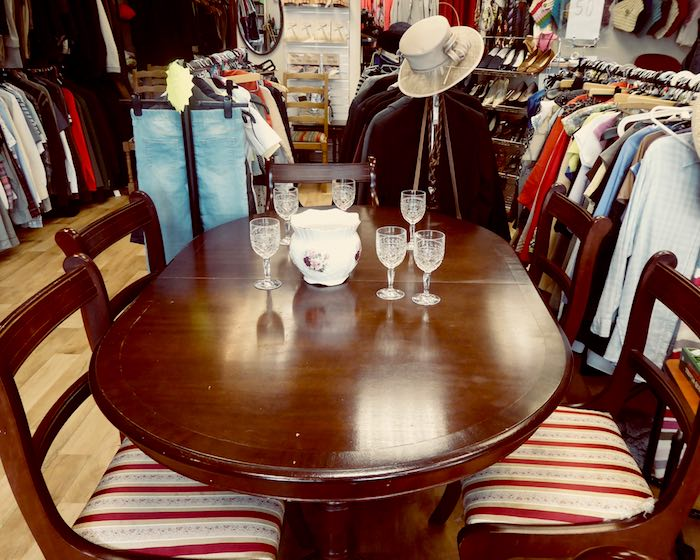 table and chairs display in charity shop