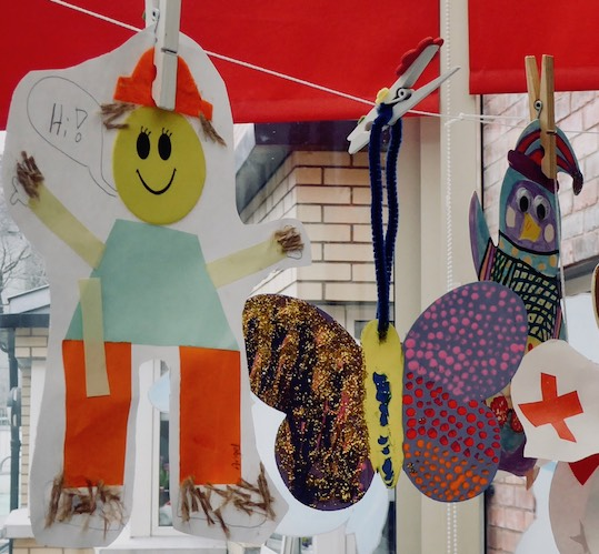 children's paintings hanging display