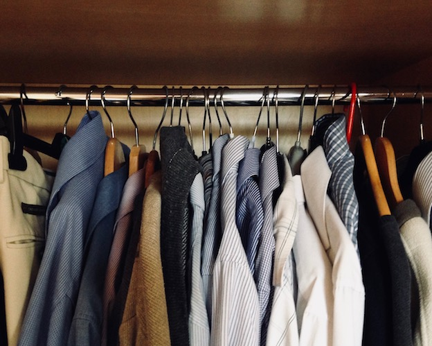 room with clothes on rail in wardrobe