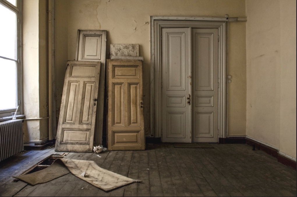 old doors propped in elegant old room