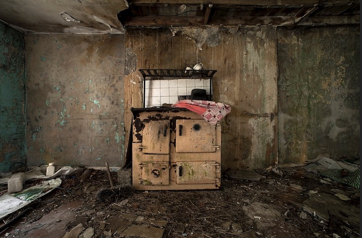 old yellow stove in ruined room