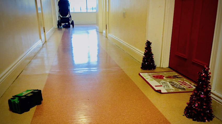 open corridor with toys and pram