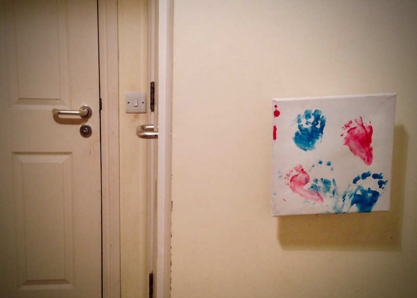childs handprint picture on wall