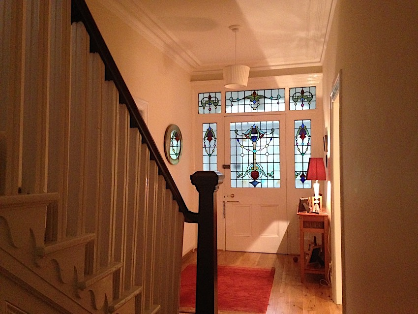 elegant hall with stairs and stained glass door