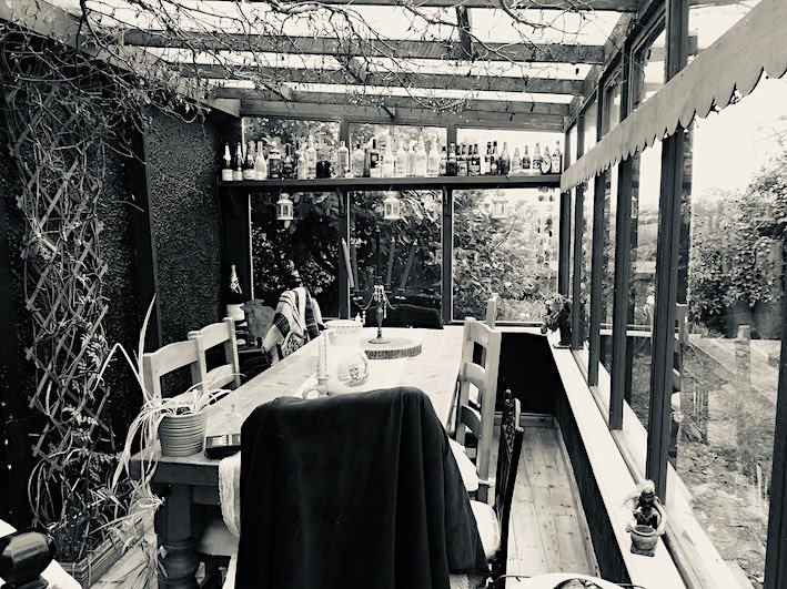 sunroom with big table in black and white