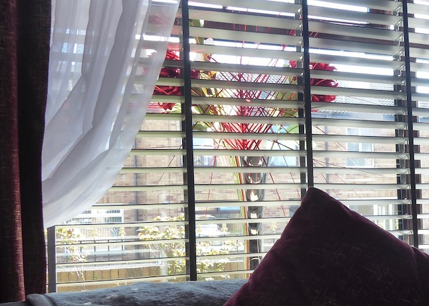 window with blinds, swags and tails