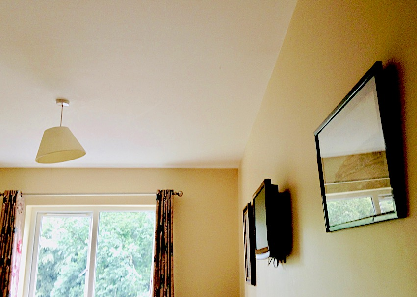 ceiling nursing home with window and pictures on wall