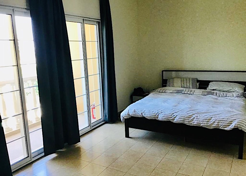 bed and window Dubai