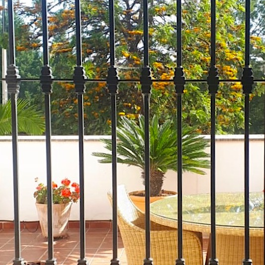view of terrace through window bars