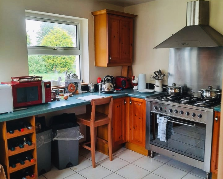 kitchen with cooker and window