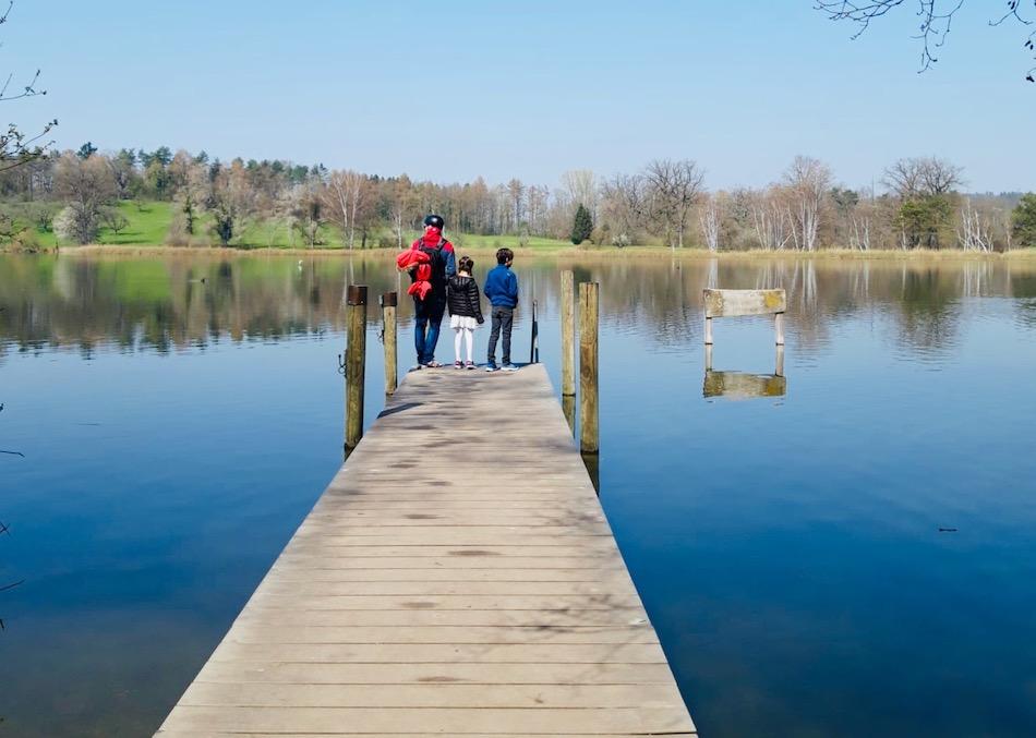 Three people by lake