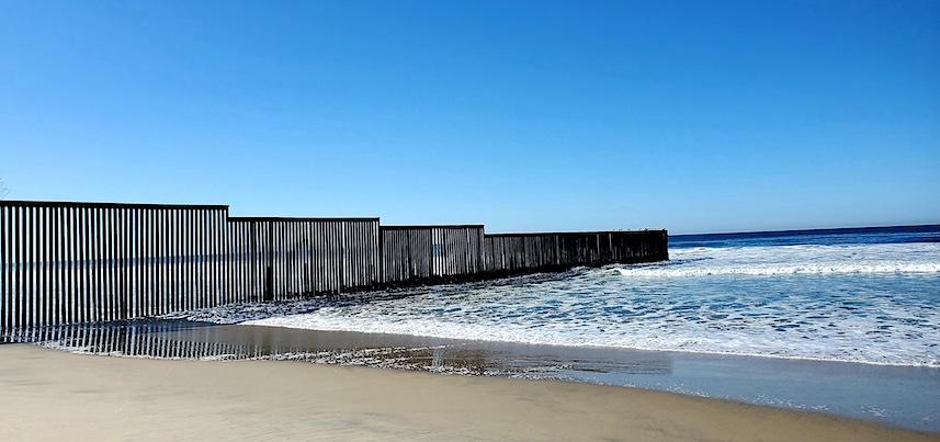 US border fence into sea