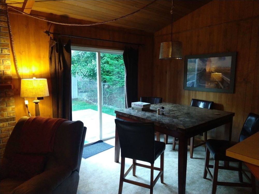 Dining room with doors out to the back deck