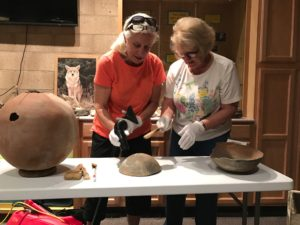 Archaeology volunteers clean Kumeyaay pots