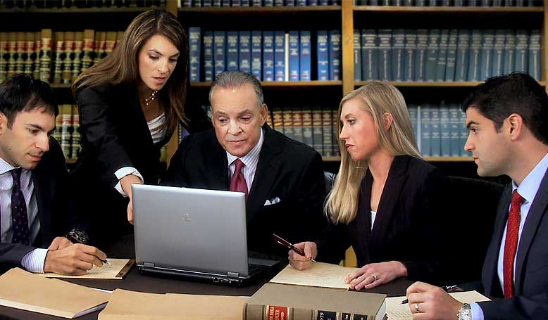 Attorney Alana Anzalone with Team   Anzalone Law Offices