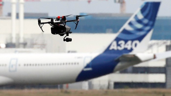 A drone flies near an Airbus A340 aircraft in Colomiers near Toulouse, France, Oct. 19, 2017. Photo by Regis Duvignau, REUTERS.