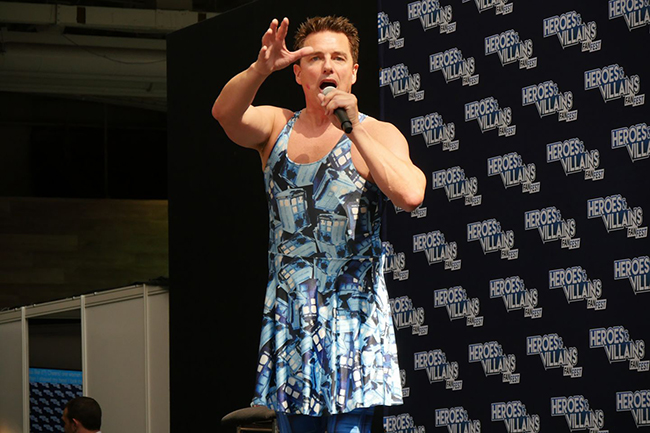 John Barrowman doing his panel in a Tardis dress