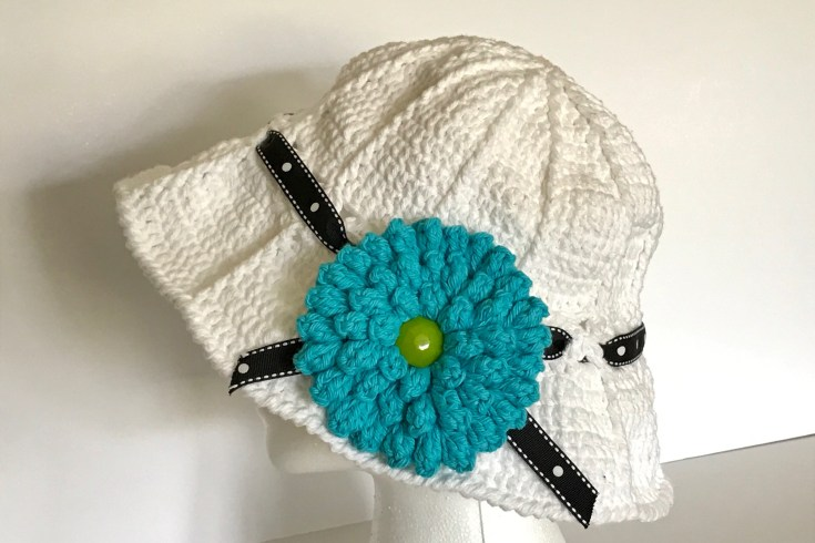 Versatile Summer Crochet Hat with Popcorn Stitch Flower