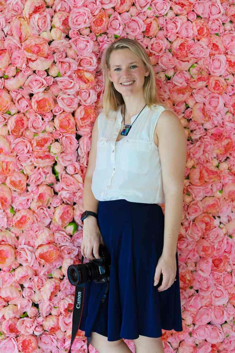 Delaney, Author of Aperture Adventure, poses with her Canon Camera