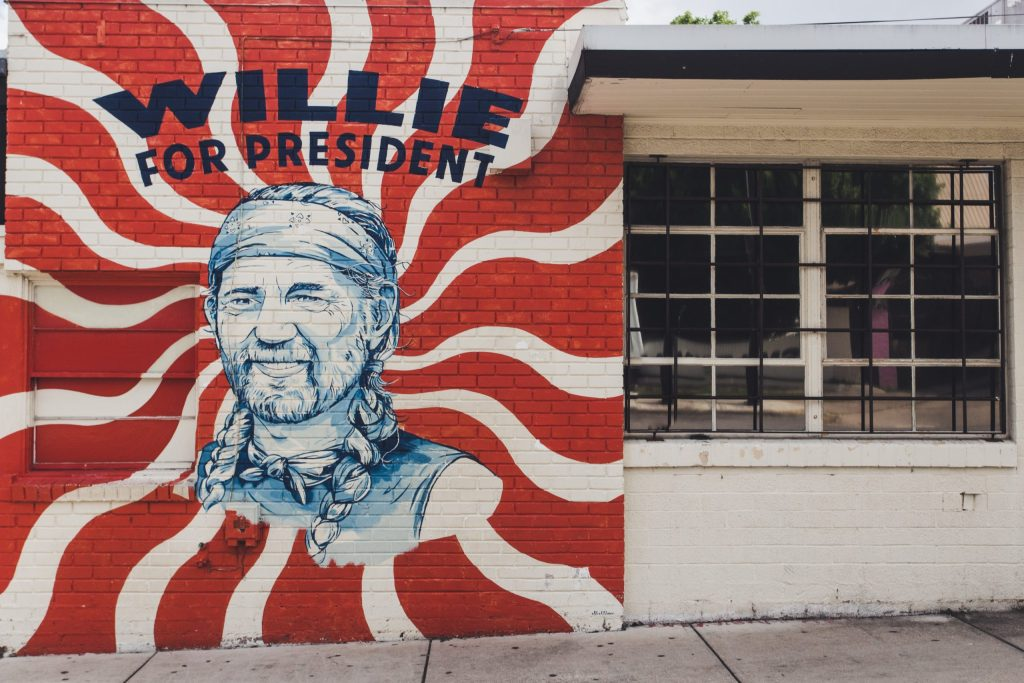 Vintage wide shot of Willie For President including neighboring window.
